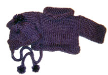 sweater and earflap hat